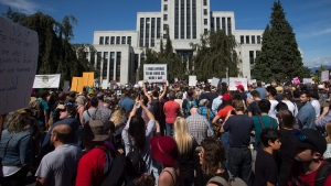 Thousands of people gather outside VancouverCity Hall as alt-right protesters and anti-racism protesters take part in rallies in Vancouver, B.C., on Saturday, August 19, 2017. THE CANADIAN PRESS/Darryl Dyck