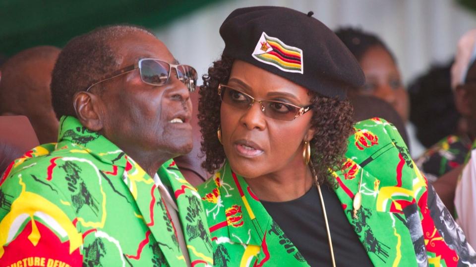 In this June, 2, 2017 file photo Zimbabwean President Robert Mugabe, left, and his wife Grace follow proceedings during a youth rally in Marondera Zimbabwe. (AP / Tsvangirayi Mukwazhi)