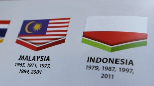 Indonesia's national flag, printed upside down, is seen on the guidebook of the Opening Ceremony of the 29th South East Asian Games in Kuala Lumpur, Malaysia on Sunday, Aug. 20, 2017. (AP / Yau)