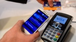 In this Wednesday, Feb. 27, 2013 photo, a man uses the NFC payment Visa system at the Mobile World Congress, the world's largest mobile phone trade show, in Barcelona, Spain. (AP / Manu Fernandez)