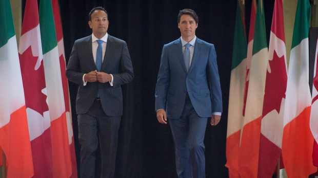 Canadian Prime Minister Justin Trudeau right, arrives with Leo Varadkar, Taoiseach of Ireland, to a ceremony at the Royal Highland Regiment Armoury, in Montreal on Sunday, August 20, 2017. (THE CANADIAN PRESS/Peter McCabe)