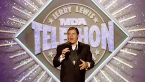 FILE - In this Sept. 2, 1990, file photo, entertainer Jerry Lewis makes his opening remarks at the 25th Anniversary of the Jerry Lewis MDA Labor Day Telethon fundraiser in Los Angeles. Lewis, the comedian whose fundraising telethons became as famous as his hit movies, has died according to his publicist. (AP Photo/Julie Markes, File)