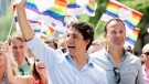 Prime Minister Justin Trudeau, left, and Irish Taoiseach Leo Varadkar, right, participate in the annual pride parade in Montreal, Sunday, August 20, 2017. THE CANADIAN PRESS/Graham Hughes