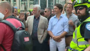 Quebec Premier Philippe Couillard, Prime Minister Justin Trudeau and Irish Prime Minister Leo Varadkar at Montreal Pride on Sunday.