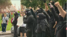 Demonstrators at the Quebec City rally reportedly threw chairs at police, lit fires in a dumpster and attacked a media photographer-- damaging his equipment. (CTV Montreal)