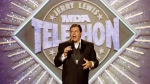 In this Sept. 2, 1990, file photo, entertainer Jerry Lewis makes his opening remarks at the 25th Anniversary of the Jerry Lewis MDA Labor Day Telethon fundraiser in Los Angeles. Lewis, the comedian whose fundraising telethons became as famous as his hit movies, has died according to his publicist. (AP Photo/Julie Markes, File)
