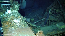 This undated image from a remotely operated underwater vehicle courtesy of Paul G. Allen, shows wreckage of the USS Indianapolis, including the ship's bell at the bottom of the North Pacific Ocean. Civilian researchers say they have located the wreck of the USS Indianapolis, the World War II heavy cruiser that played a critical role in the atomic bombing of Hiroshima before being struck by Japanese torpedoes. The expedition crew of Research Vessel Petrel, which is owned by Microsoft co-founder Allen, says it located the wreckage of the Indianapolis on the floor of the North Pacific Ocean, more than 18,000 feet (5,500 meters) below the surface, the U.S. Navy said in a news release Saturday, Aug. 19, 2017.(Courtesy of Paul G. Allen via AP)
