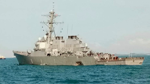 In this photo released by the Royal Malaysian Navy, the U.S guided-missile destroyer USS John S. McCain is seen after a collision, off Johor, Malaysia, Monday, Aug. 21, 2017. (Royal Malaysian Navy via AP)