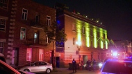 Police stand watch outside a nightclub in the Gay Village after a 29-year-old man fell from the roof (CTV Montreal/Cosmo Santamaria)