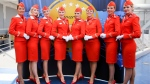 In this photo taken on Tuesday, June 20, 2017, some of Aeroflot's flight attendants pose for a photo at the World's Best Airline at the 2017 Skytrax World Airline Awards celebration at Paris Air Show, in Le Bourget, east of Paris, France. (AP / Marina Lystseva)