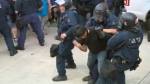 Riot police arrest counter-protest organizer Jaggi Singh in Quebec City on Sunday August 20, 2017
