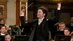 In this Jan. 1, 2017 file photo, maestro Gustavo Dudamel of Venezuela conducts the Vienna Philharmonic Orchestra during the traditional New Year's Concert at the Golden Hall of the Musikverein in Vienna, Austria.  (AP Photo/Ronald Zak, File)