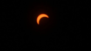 In this photo taken through a solar filter, 80 percent of the sun above Calgary was covered by the Moon on August 21.