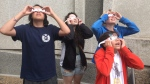 At the Manitoba Museum, people rushed outside to see it and put on special disposable glasses designed to protect the eyes from the sun's glare. (Source: Beth Macdonell/CTV News)