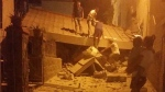People remove debris after an earthquake hit Ischia island, near Naples, Southern Italy, Monday, Aug. 21, 2017. (Serenella Mattera/ANSA via AP)