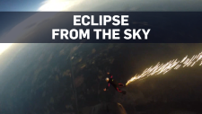 Skydivers watch eclipse while falling from sky