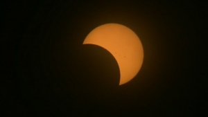 Millions of Canadians turned their eyes to the sky on Monday to take in a rare partial solar eclipse.