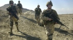 FILE - In this Feb. 11, 2003 file photo, U.S. soldiers patrol the perimeter of a weapons cache four miles of the U.S. military base in Bagram, Afghanistan. (AP Photo/Aaron Favila)