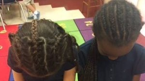 Brigette Diez Kerr swallowed her concerns and tried her best to recreate the tight braids Concetta asked for. The child's reaction instantly confirmed that she had made the right decision. (Facebook)