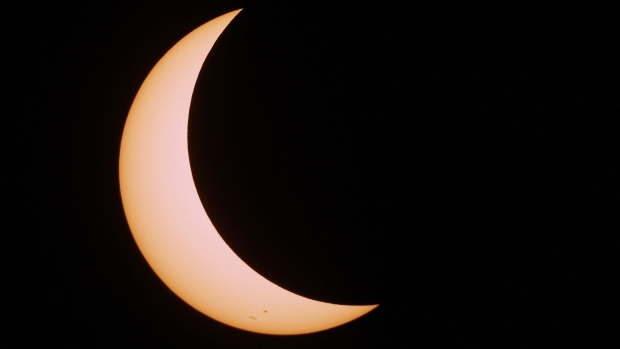 The moon covers most of the sun as hundreds of people gathered at Western University to view the partial solar eclipse, in London, Ont. on Monday, Aug. 21, 2017. Photographed with a 8-inch reflecting telescope. THE CANADIAN PRESS/Dave Chidley