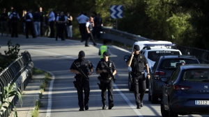 Armed policemen walk on a road near Subirats, Spain, during an operation on Monday, Aug. 21, 2017. (AP / Emilio Morenatti)