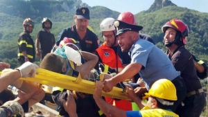 Firefighters and rescuers pull out a boy, Mattias, from the collapsed building in Casamicciola, on the island of Ischia, near Naples, Italy, a day after a 4.0-magnitude quake hit the Italian resort island on Tuesday, Aug. 22, 2017 (Italian Carabinieri / HO)