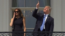 Extended: Trump looks up during eclipse
