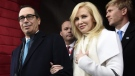 In this Friday, Jan. 20, 2017, file photo, then Treasury Secretary-designate Stephen Mnuchin and his then-fiancee, Louise Linton, arrive on Capitol Hill in Washington, for the presidential inauguration of Donald Trump. (Saul Loeb/Pool Photo via AP, File)