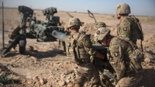 "FILE - In this June 10, 2017 photo provided by Operation Resolute Support, U.S. Soldiers with Task Force Iron maneuver an M-777 howitzer, so it can be towed into position at Bost Airfield, Afghanistan. Reversing his past calls for a speedy exit, U.S. President Donald Trump recommitted the United States to the 16-year-old war in Afghanistan Monday night, Aug. 21, 2017, declaring U.S. troops must ""fight to win."" He pointedly declined to disclose how many more troops will be dispatched to wage America's longest war.(U.S. Marine Corps photo by Sgt. Justin T. Updegraff, Operation Resolute Support via AP, File)"