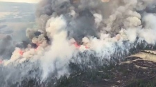 The Verdant Creek fire is about 14,000 hectares in size and has forced the closure of many areas in Banff and Kootenay National Parks.