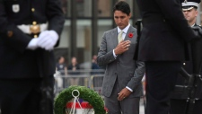 Prime Minister Justin Trudeau makes the sign of the cross as he lays a wreath during a ceremony in honour of the 75th anniversary of the Dieppe Raid, at the National War Memorial in Ottawa on Tuesday, Aug. 22, 2017. THE CANADIAN PRESS/Justin Tang