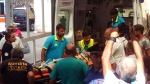 Ciro, the eldest of three boys saved by rescuers from the ruins of a house which collapsed following a 4.0-magnitude quake, is unloaded on a stretcher from an ambulance on the resort island of Ischia, near Naples, Italy, Tuesday, Aut. 22, 2017. Italian firefighters have extracted the third and final brother from the rubble of their home that collapsed Monday evening. (Mauro Iovino/ANSA via AP)