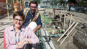 Chief archeologist Louise Pothier and the director of operations Hendrik Van Gijseghem are seen on the site of the archeological dig of the pre-Confederation parliament, Monday, August 14, 2017 in Montreal. (Paul Chiasson / THE CANADIAN PRESS)