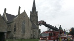 Crews battle fire in steeple of church