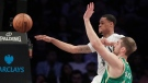 Brooklyn Nets guard K.J. McDaniels (14) passes the ball away from Boston Celtics center Tyler Zeller (44) during the third quarter of an NBA basketball game, Friday, March 17, 2017, in New York. The Celtics won 98-95. (AP Photo/Julie Jacobson)