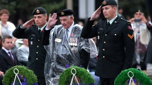 Veteran Stan Edwards, centre, lays a wreath on behalf of veterans during a ceremony in honour of the 75th anniversary of the Dieppe Raid, at the National War Memorial in Ottawa on Tuesday, Aug. 22, 2017. (Justin Tang / THE CANADIAN PRESS)