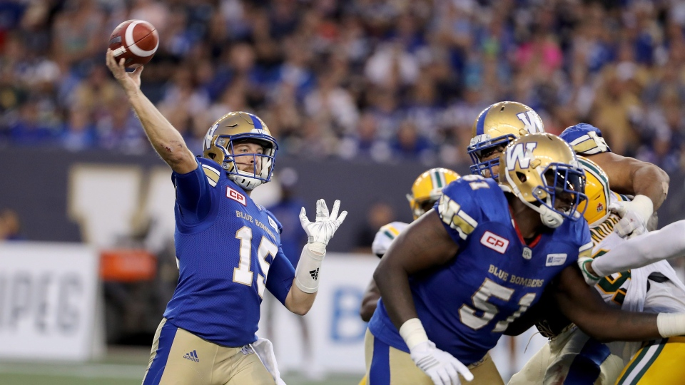 Winnipeg Blue Bombers quarterback Matt Nichols (15) fires a pass while playing against the Edmonton Eskimos during the first half of CFL football action in Winnipeg, Thursday, August 17, 2017. (THE CANADIAN PRESS/Trevor Hagan)