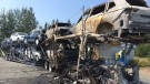 These vehicles were scorched when the transport truck that was carrying them caught fire in Baddeck, N.S.