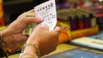A customer buys a Powerball ticket, Tuesday, Aug. 22, 2017, in Chicago. (AP / G-Jun Yam)