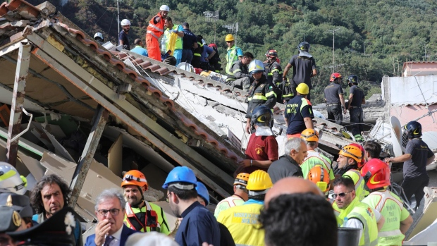 Rescuers work on the site of a collapsed building a day after a 4.0-magnitude quake hit the resort island of Ischia, near Naples, Italy. (ANSA via AP)