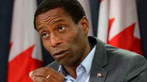 Greg Fergus speaks during a press conference in Ottawa on Saturday, September 12, 2015. Fergus says the plan to legalize marijuana should take into account the fact that the black community has been disproportionately criminalized for using the drug. [Justin Tang / THE CANADIAN PRESS]