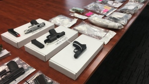 Drugs and weapons seized as part of a Surrey RCMP investigation are seen in this photo from Tuesday, Aug. 22.