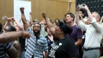 Protesters yell during the Charlottesville City Council meeting Monday, Aug. 21, 2017, in Charlottesville, Va. (Andrew Shurtleff / The Daily Progress via AP)