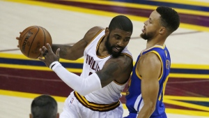Cleveland Cavaliers guard Kyrie Irving is guarded by Golden State Warriors guard Stephen Curry during the first half of Game 3 of basketball's NBA Finals in Cleveland on June 7, 2017. (AP / Ron Schwane)