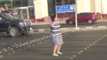 The video shows the boy with head phones and wearing grey sweat shorts, a striped T-shirt and neon green and yellow Crocs on his feet. (Ahmed Al Omran/Twitter)