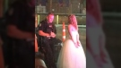 A police officer is shown with a bride who was arrested in Edmonton on Saturday, Aug. 19, 2017. (@IAmByks / Twitter)