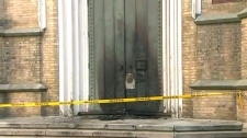 The door to Trinity Church near the Eaton Centre was charred after a suspect allegedly set several small fires in the area on August 23, 2017.