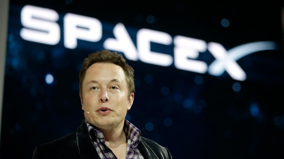 Elon Musk, CEO and CTO of SpaceX, introduces the SpaceX Dragon V2 spaceship at the SpaceX headquarters in Hawthorne, Calif. on May 29, 2014. (AP / Jae C. Hong)