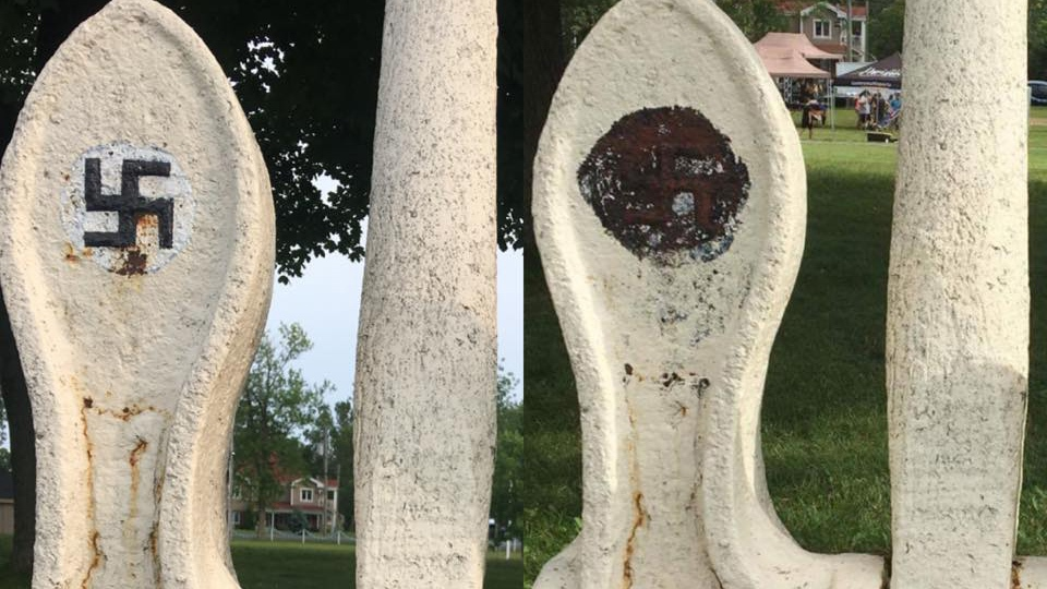 A before and after picture shows the anchor with the swastika outlined in black by the city (left) and the anchor after Corey Fleischer removed the paint (right). (Corey Fleischer/Facebook)