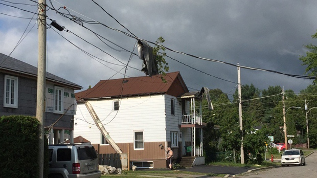 Part of a roof was ripped off a house in Lachute, and shingles are wrapped around power lines following a possible tornado (CTV Montreal/Derek Conlon)